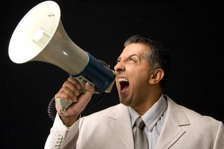 bellowing: Ceo shouting loud through megaphone Stock Photo