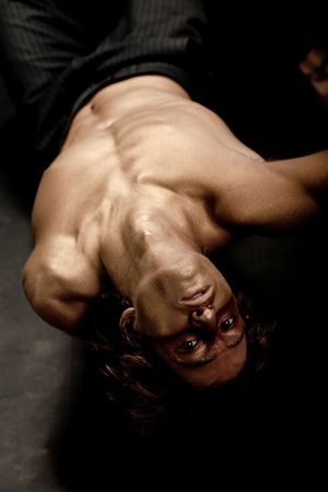upside down: Handsome young guy upside down Stock Photo