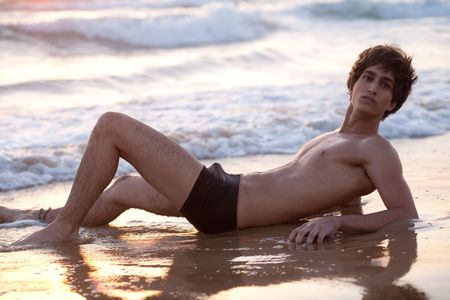 beach hunk: Handsome male model by the beach Stock Photo