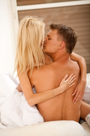 lovers kissing in bed Stock Photo - 5291914