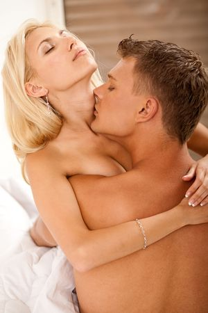 Passionate couple enjoying in bed