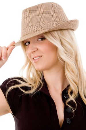 portrait of smiling female holding hat on an isolated background photo