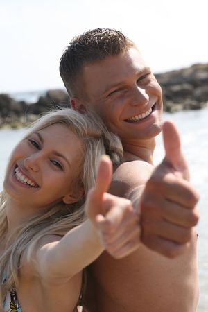Young couple posing at the beach photo