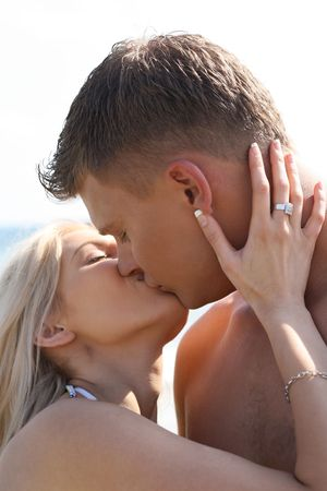 young couple kissing: Close-up of young couple kissing Stock Photo