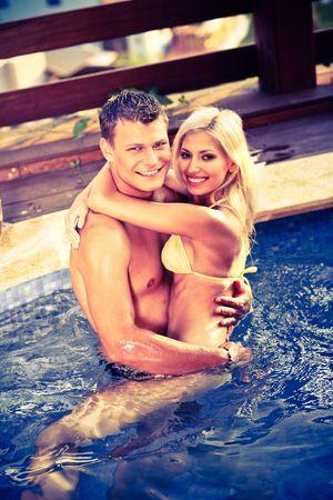Happy couple in the pool photo