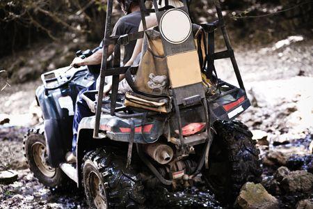 Couple having pleasure ride on ATV photo