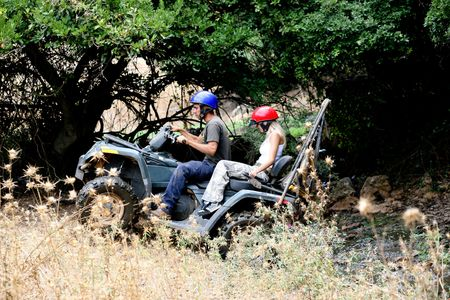 ATV climbing with lush green background photo