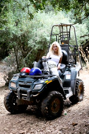 Portrait of beautiful woman after an ATV adventure photo