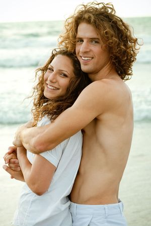 Young affectionate couple embracing photo