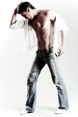 bare chest: Male model posing in style with his head down