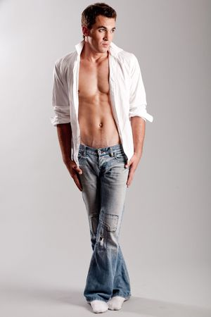 bare chest: Caucasian male standing crossed-leg and looking away