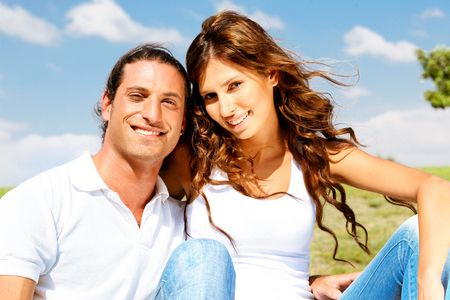 Young couple posing in front of camera on natural background Standard-Bild