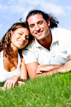 Affectionate couple smiling and relaxing facing camera photo
