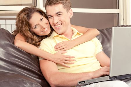 Mid adult couple with laptop photo