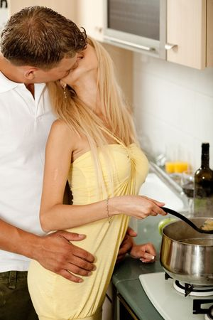 Love couple kissing in kitchen photo