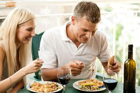 Man and woman dining  Standard-Bild