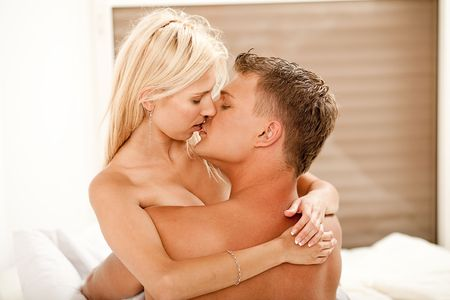 Guy and lady kissing and embracing each other Stock Photo