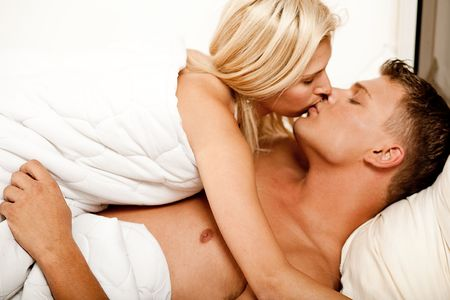 Man and woman kissing in bed Stock Photo - 5610064