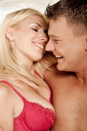 Man and woman having fun in bed during foreplay Stock Photo - 5746377