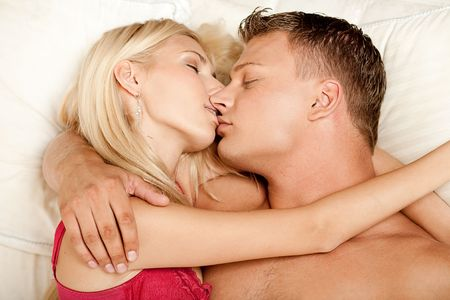 Intimate lovers embrace and kissing at sleep Stock Photo - 5746376