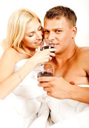 Young couple enjoying drink at erotic honeymoon
