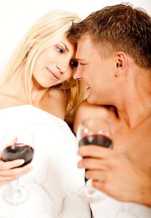 Mid adult couple enjoying wine during foreplay