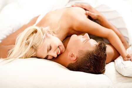 Portrait of younghappy couple in bed having fun