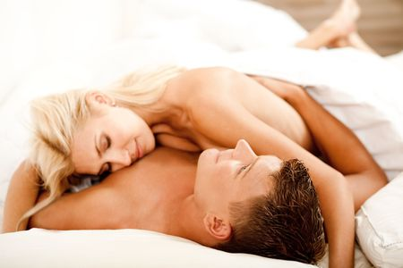 Mid adult couple relaxing as woman lies on top of her man Stock Photo - 5674050