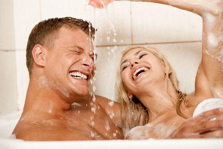 foreplay: Playful couple enjoying in bath
