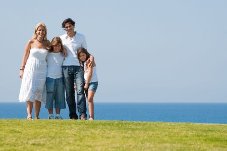 Smiling happy family on natural background