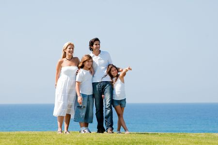 Family enjoying weekend on meadow together photo