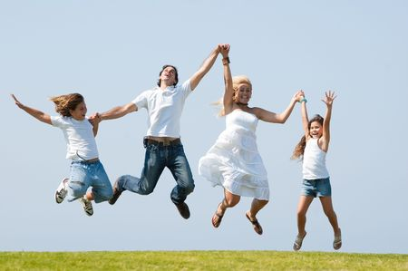 Happy family jumping high against natural background