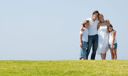 portarit: Portarit of lovable young family on herb under the sky Stock Photo
