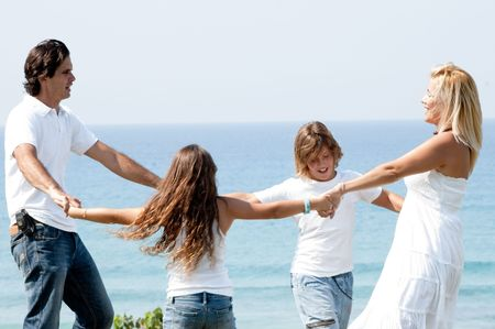 Family having fun at coast and enjoying beautiful day