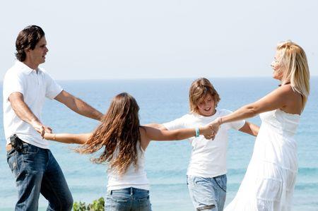 Family having fun at coast and enjoying beautiful day photo