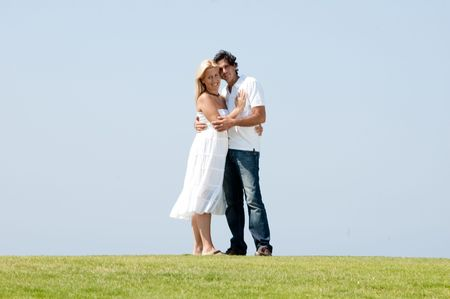 Young couple hugging on natural background Standard-Bild