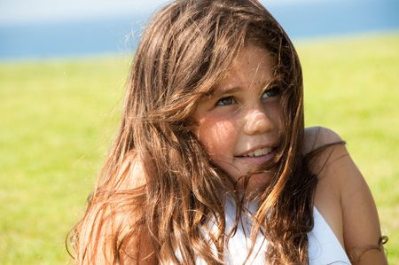 Young girl relaxing on a meadow Standard-Bild