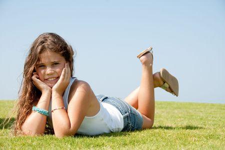 Teen smiling at camera Standard-Bild
