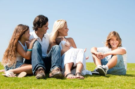 Happy family relaxing on grass
