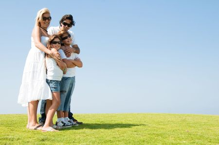 Family posing on natural background