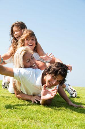Family having fun on meadow