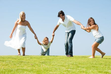 Family playing around on natural background
