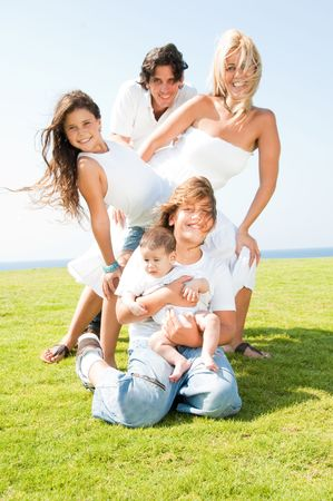 Family of five posing in style on natural background Standard-Bild