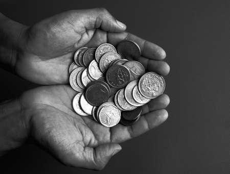 wrist cuffs: offering cash Stock Photo