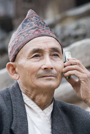Close-up of a senior man talking on a mobile phone photo