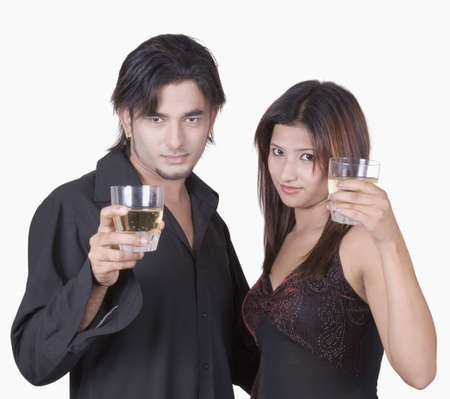 Portrait of a young couple holding glasses of wine photo