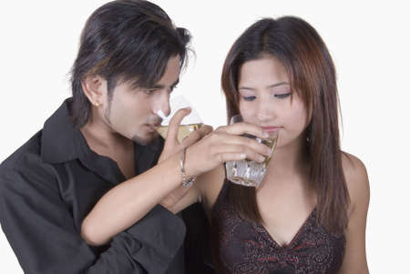 Close-up of a young couple drinking white wine photo
