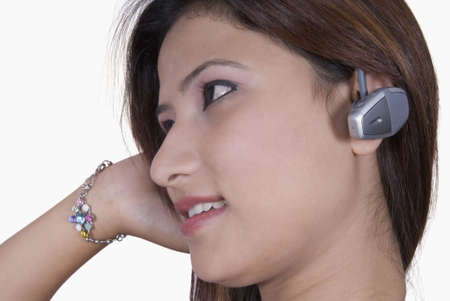 hands free device: Side profile of a young woman wearing a hands free device