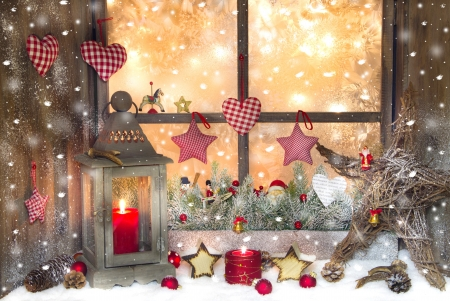 sill: Red Christmas decoration with lantern on window sill Stock Photo