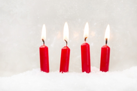 x mas: Four red candle on white background